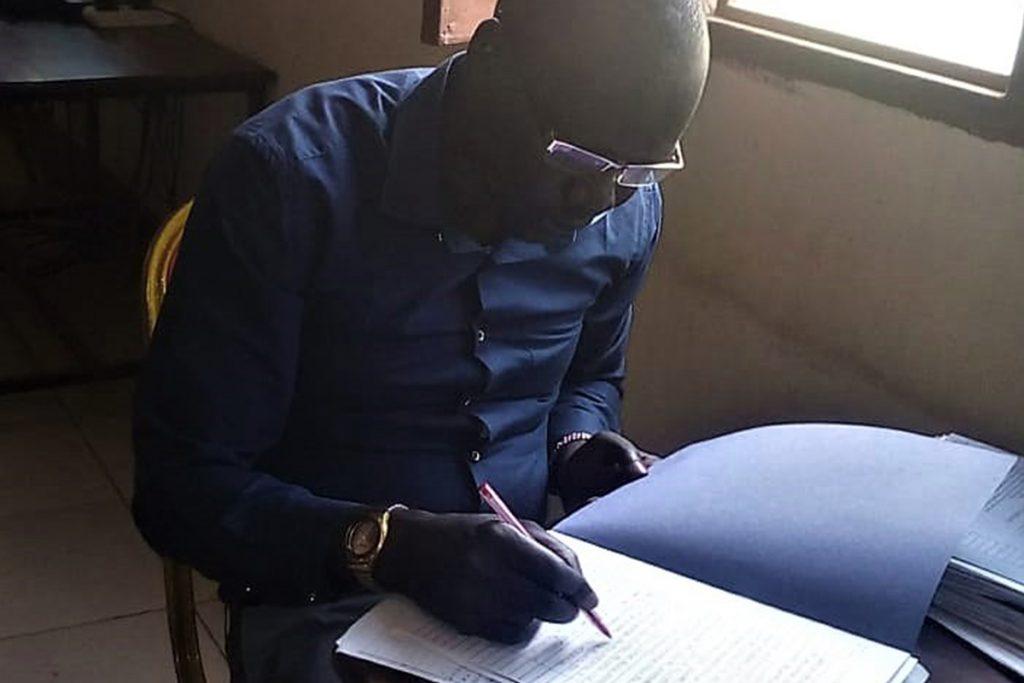 John-marking-Bible-college-exams